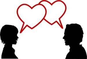 silhouette couple talk love in heart speech bubbles